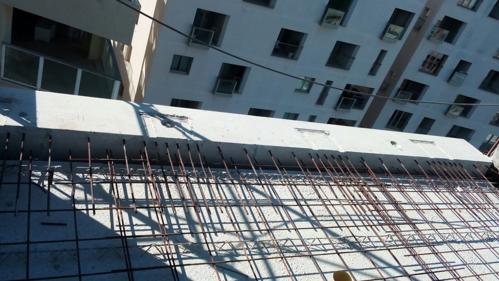 Installed edge Fascia Beam including Brackets prepared for the installation of the Glass Façade